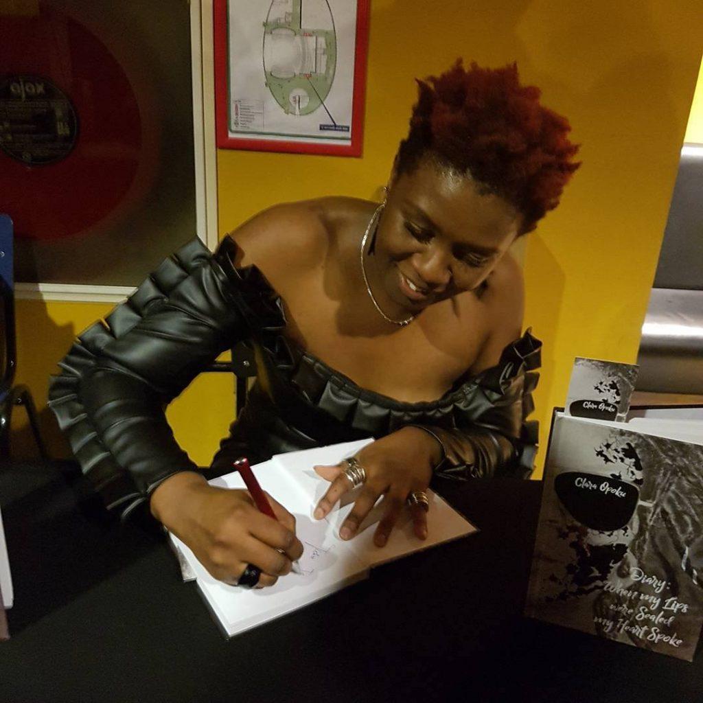 Clara Opoku signing